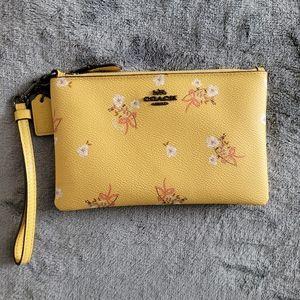 Coach floral bow wristlet